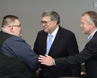U.S. Attorney General William Barr, center, shakes hands with Richard Peterson, president of the Central Council of the Tlingit and Haida Indian Tribes of Alaska, in Anchorage on May 29, 2019. U.S. Sen. Dan Sullivan, R-Alaska, is at right.