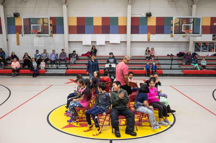 "Children play musical chairs during a celebration of life event at the Kiana school. The event was organized in response to two recent suicides in the region. Officials were worried that deaths might ignite one of the ""clusters"" of suicides that sometimes plague this part of the state."