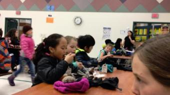 "Anchorage students eating during a ""silent lunch."" (Screen grab of a Health, Wellness, Nutrition, and Student Learning Ad Hoc committee presentation via Kelly Lessens)"