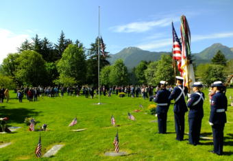 U.S. Coast Guard color guard prepares stands ready before the Memorial Day service at Evergreen Cemetery on May 27, 2019.