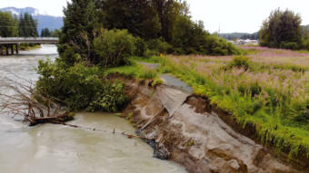 A trail runs off the edge of the eroded bank of the Mendenhall River near Brotherhood Bridge on August 10, 2018.