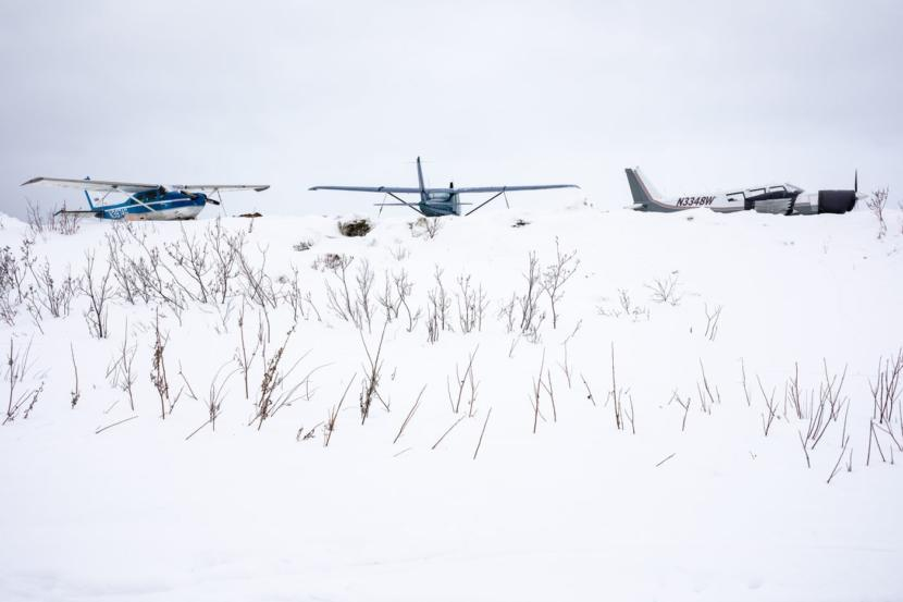 Airplanes at the Kiana airport in March. Only about 14% of Alaska villages and cities can be reached by road, leaving many Alaskans reliant on boats or single-engine planes, which are often grounded when the weather is bad.
