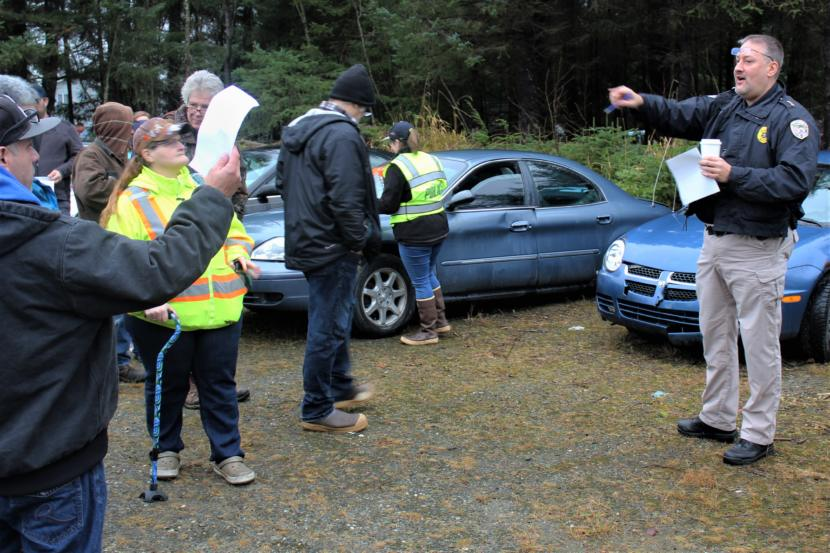 Juneau Police Department Deputy Chief David Campbell serves as the auctioneer at a police car auction in the city's Lemon Creek impound lot in November 2018.