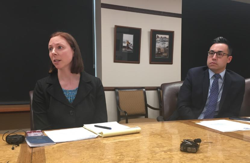 Assistant Attorney General Cori Mills responds to a reporter's question during a press availability regarding a dispute over school funding, May 9, 2019. Matt Shuckerow, Gov. Mike Dunleavy's press secretary, is on the right. (Photo by Andrew Kitchenman/KTOO and Alaska Public Media)