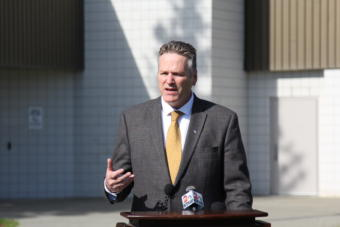 Alaska Gov. Mike Dunleavy speaks at a press conference in front of Wasilla Middle School.