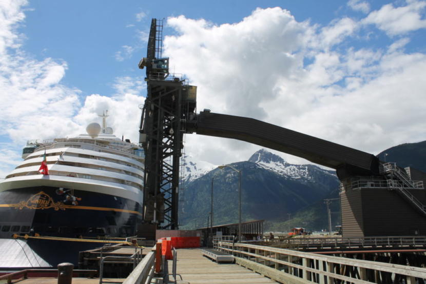 The Disney Wonder cruise ship docks near the ship loader at Skagway's ore terminal. (Photo by Henry Leasia/KHNS)