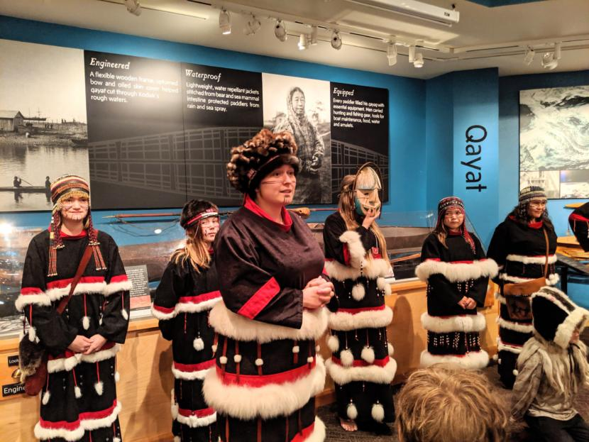 Candace Branson introduces the next song she and and her fellow Alutiiq dancers will perform.