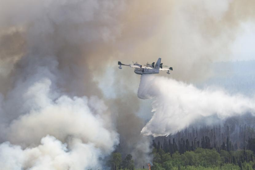 A plane assists in fighting a wildfire at Montana Creek near Talkeetna, Alaska, July 4, 2019.