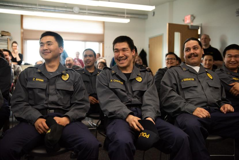 Graduates Nunapitchuk VPO Zachariah Brink, Quinhagak TPO Phillip Charlie, and Afognak Officer Jess Eggemeyer II at the Rural Law Enforcement Training at Yuut Elitnaurviat in Bethel on June 14, 2019.