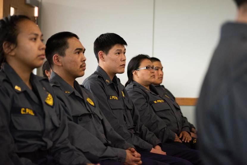 Yukon-Kuskokwim Delta officers wait to receive their graduation certificates from Rural Law Enforcement Training at Yuut Elitnaurviat in Bethel on June 14, 2019.