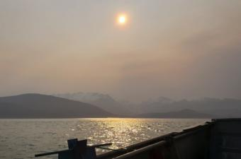 Particulate matter in the air obscures the sun and the view of Herbert Glacier from Lynn Canal near Juneau early on the morning of June 30, 2019.