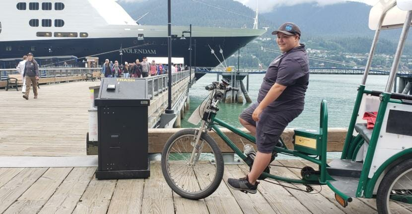 Theo Houck looks for pedicab passengers as Volendam passengers disembark in downtown Juneau on July 12, 2019. Houck had taken 6 days off because air quality had gotten unhealthy and he asthma-like symptoms.