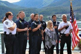 Ashley DeRamus recites the Pledge of Allegiance with members of Capital City Fire/Rescue. (Photo by Adelyn Baxter/KTOO)