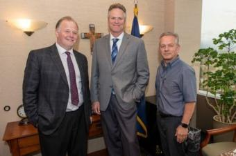 Outgoing chief of staff Tuckerman Babcock, Gov. Mike Dunleavy and incoming chief of staff Ben Stevens pose for a photo that accompanied the announcement of that Stevens is succeeding Babcock. (Photo courtesy of the governor's office)