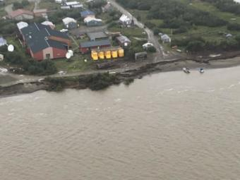 The Napakiak School fuel storage facility sits 76 feet from the riverbank's erosion point, along the Kuskokwin River in Alaska, Aug. 16, 2019.