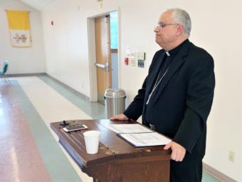 Bishop Andrew Bellisario addresses reporters at St. Ann's Parish Hall on August 21, 2019. (Photo by Adelyn Baxter/KTOO)