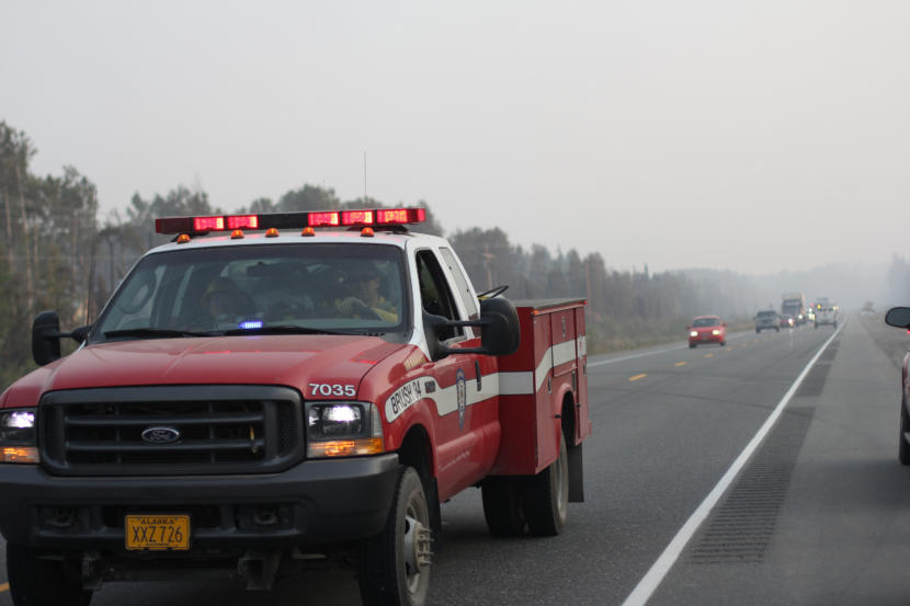 A Chugiak Volunteer Fire and Rescue Company firefighter passes traffic along the Parks Highway on Tuesday, Aug. 20, 2019.