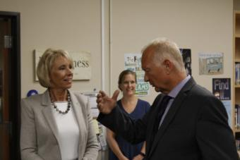 U.S. Education Secretary Betsy DeVos speaks with Mat-Su Central School principal John Brown. Brown toured DeVos around the school on Aug. 26, 2019. (Photo by Wesley Early, Alaska Public Media – Anchorage)