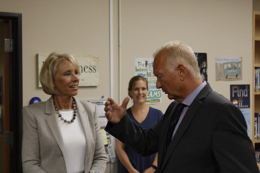U.S. Education Secretary Betsy DeVos speaks with Mat-Su Central School principal John Brown.