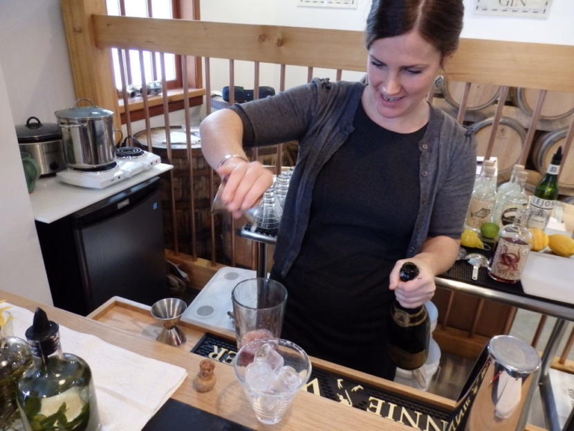 Macky Cassidy mixes a cocktail in the Port Chilkoot Distillery tasting room.