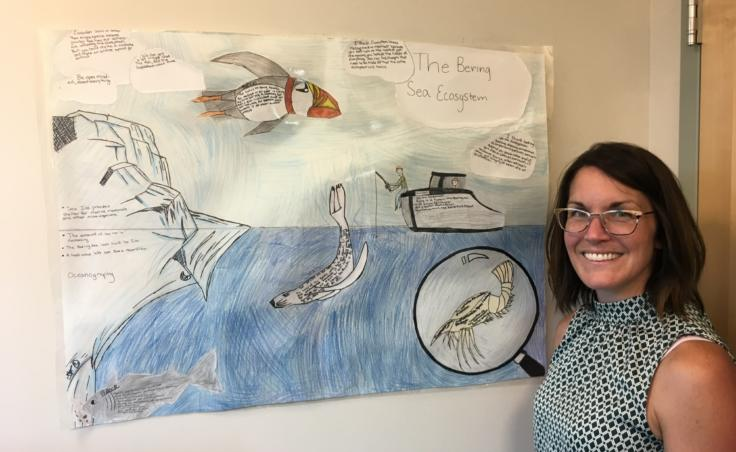 Elizabeth Siddon worked with a life sciences teacher at Floyd Dryden Middle School to develop a 6-week curriculum to explore the Bering Sea marine ecosystem. A poster created by students hangs on her office wall, photographed on Aug. 1, 2019. (Photo by Zoe Grueskin/KTOO)