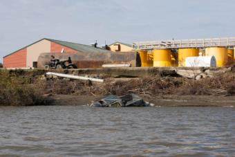 This fuel tank farm now sits empty after rapid erosion forced the Lower Kuskokwim School District to transfer the fuel to new tanks behind the school in Napakiak, Aug. 30, 2019.