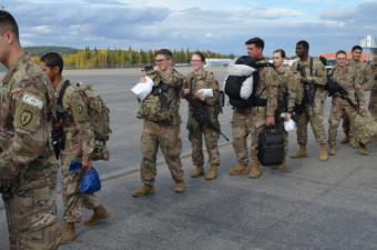 U.S. Army soldiers wait to depart from Fort Wainwright.