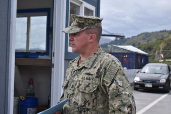 Senior Chief Petty Officer Brandon Raile stands on Kodiak's Pier 2 outside the USS Comstock, Sept. 10, 2019.
