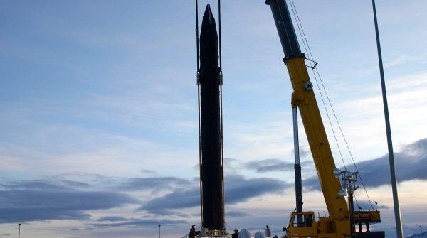 One of the 40 interceptor missiles at Fort Greely is lowered into its silo. An expansion project at the missile-defense base eventually will increase the number of interceptors at Greely to 60. Four more interceptors are based at Vandenberg Air Force Base, Calif. (Photo courtesy of Missile Defense Agency)