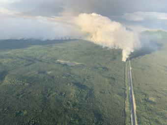 A plume of smoke rises near the Sterling Highway in this aerial photo.