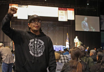 Alaska Native organizer and activist Samuel Johns protests during a speech by Gov. Mike Dunleavy at the 2019 Alaska Federation of Natives Conference at the Carlson Center in Fairbanks.