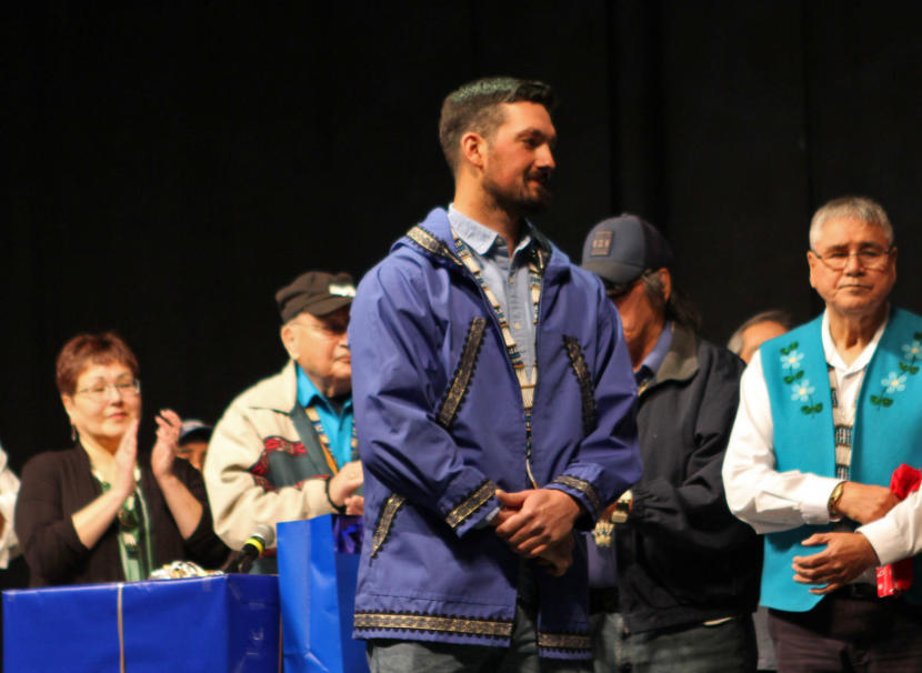 Pete Kaiser receives gifts and awards after his speech at the 2019 Alaska Federation of Natives Conference at the Carlson Center in Fairbanks.