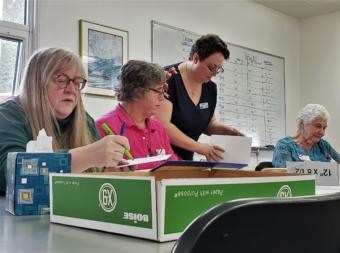 Juneau election workers check absentee and questioned ballots in a conference room at City Hall on Friday, Oct. 4, 2019. From left to right: Hali Denton, Andy Peterson, Beth McEwen and Betty Cook.