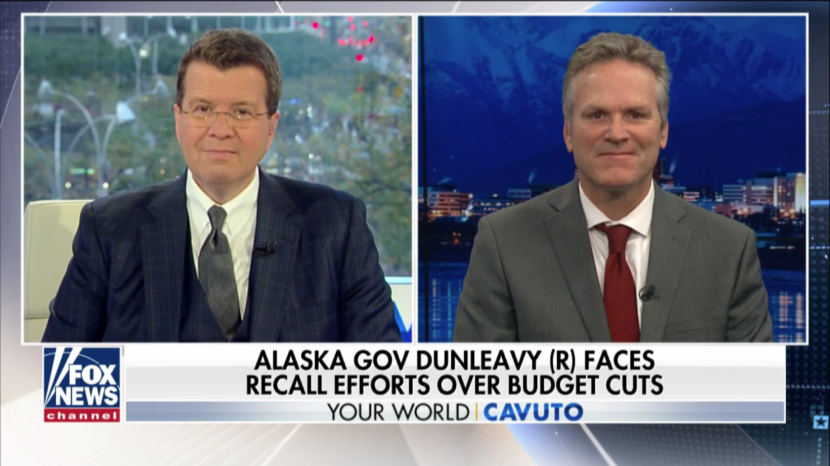 Gov. Mike Dunleavy, left, appears on Fox News with host Neil Cavuto. Dunleavy has reached conservatives through several national media appearances. (Screen capture from Fox News: https://video.foxnews.com/v/6096004523001/#sp=show-clips)