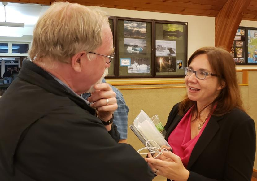 Deacon Charles Rohrbacher of the Catholic Diocese of Juneau talks with climate scientist and Evangelical Christian Katharine Hayhoe at Chapel by the Lake in Juneau on Sept. 13, 2019. Hayhoe, a Texas Tech University professor, said she stacked 29 events around Alaska into her trip.