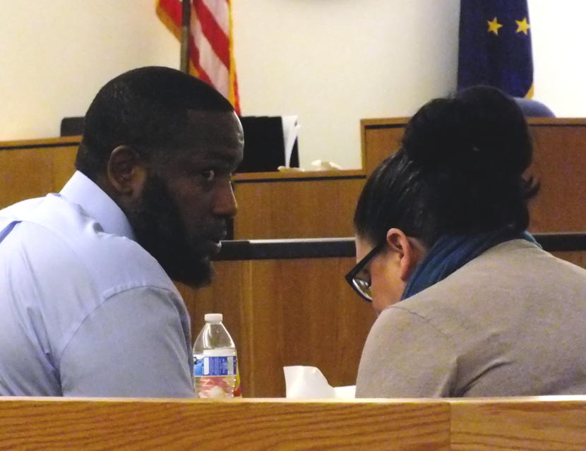 Defendant Laron Graham confers with his attorney Natasha Norris during a break in closing arguments Monday, Oct. 7, 2019. in the double homicide trial in Juneau Superior Court.