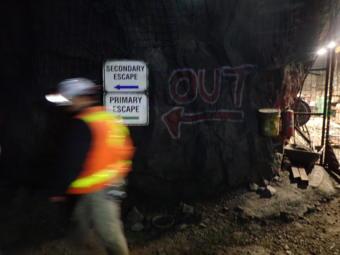 A manager walks past Kensington Gold Mine's Elmira deposit on Oct. 15, 2019.