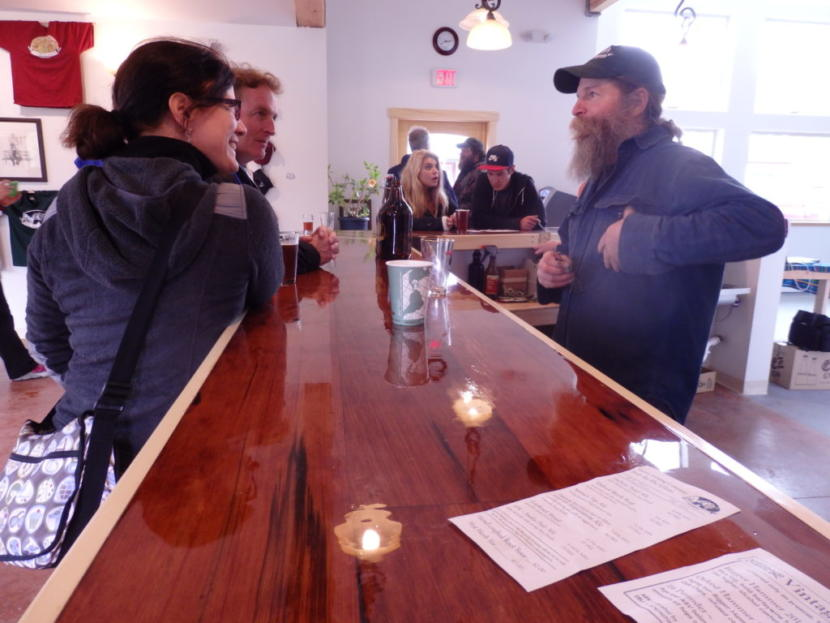 Haines Brewing co-owner Paul Wheeler speaks to customers at the brewery. (Photo by Emily Files/KHNS)