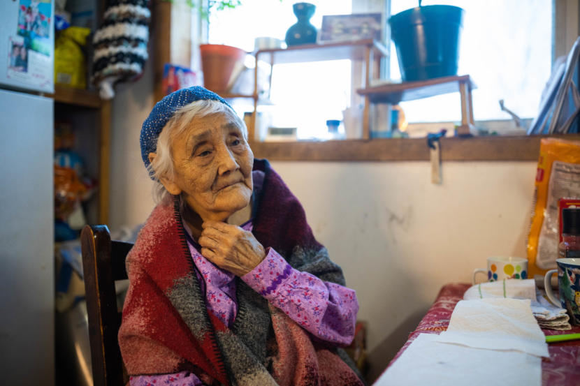 Marie Askoak, 90, sits at her kitchen table on March 7, 2019 in Russian Mission. Askoak is the oldest person in the village. (Photo by Loren Holmes/Anchorage Daily News)