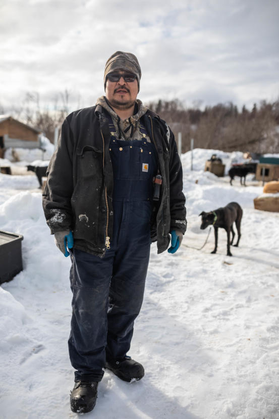 Basil Larson stands in his dog yard on March 8, 2019 in Russian Mission. He often carries a handgun while mushing for protection from wildlife. (Loren Holmes / ADN)