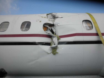 A preliminary National Transportation Safety Board investigation into a fatal PenAir crash in Dutch Harbor on Oct. 17, 2019, includes this photo of damage to the left side of the plane.
