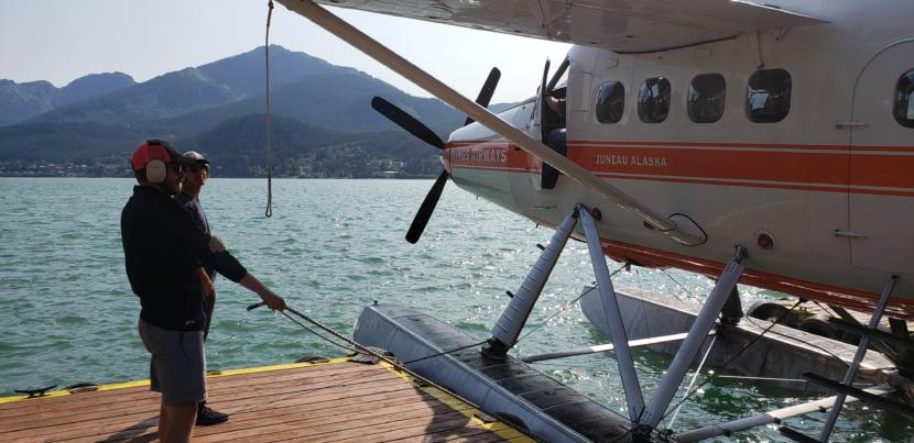 Workers with Wings Airways and Taku Glacier Lodge prepare a floatplane for takeoff in downtown Juneau on Aug. 31, 2019. In the 2000s, the City and Borough of Juneau paid for noise abatement and flightseeing mediation with cruise ship passenger taxes.