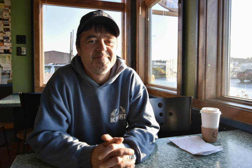 Darius Kasprzak, a jig fisherman, sits down for coffee near the Kodiak harbor. (Photo by Kavitha George/Alaska's Energy Desk)
