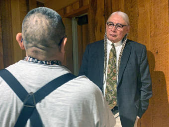 Walter Echo-Hawk talks to a man after giving a speech on the 1955 Tee-Hit-Ton Tlingit loss of a Supreme Court case on Nov. 7, 2019, in Juneau. (Photo by Rashah McChesney/Alaska's Energy Desk)
