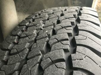 A closeup shot of the treads on a tire.