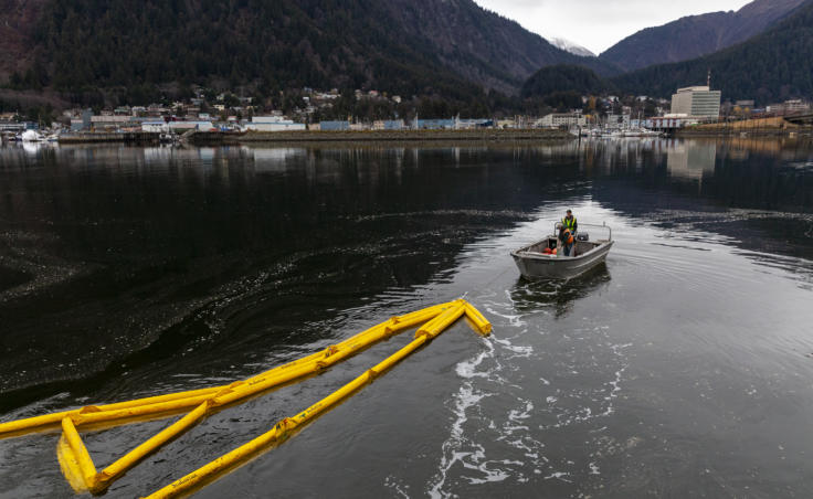 Petro Marine employees deploy bright yellow boom around their dock on Wednesday, Nov. 6, 2019 in the Gastineau Channel. The company is drilling its response to contain oil spills.