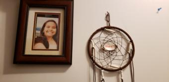 "A photo of Abby Kelley and a dream catcher hang on a wall in her family's home in Juneau on Dec. 2, 2019. Her parents say that she ""had dimples for days."""