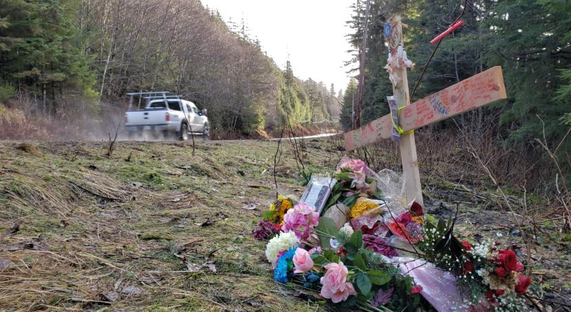 Traffic zooms by a makeshift memorial to Abby Kelley near Mile 21 of Glacier Highway in Juneau on Dec. 2, 2019. Kelley, 19, and Keith Brososky Jr., 15, died after the car they were riding in sped off the road nearby on Nov. 21, 2019.