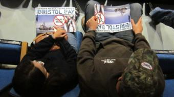 Activists hold anti-Pebble Mine posters at an EPA meeting in 2012. Photo by Daysha Eaton.
