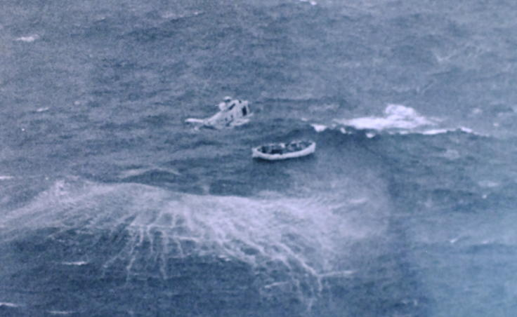 A helicopter prepares to rescue survivors from a life raft during the Prisendam rescue in October 1980. (Photo courtesy of U.S. Coast Guard